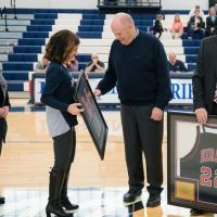 presenting a plaque to Bill Meyer '66 on his jersey retirement day