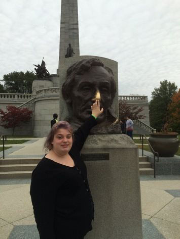 Student posing with president lincoln