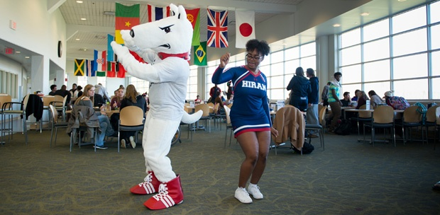 terrier mascot dancing with a cheerleader